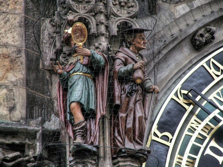 Figures representing Vanity (on the left) and Greed or Usury (on the right), Astronomical Clock, Orloj, Prague, the Czech Republic